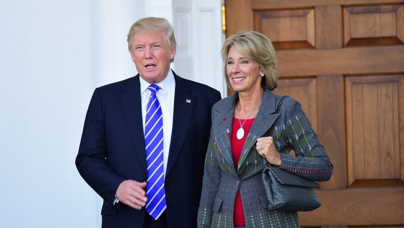 President Donald Trump and Secretary of Education Betsy DeVos in a November, 2016 file photo. Photo credit: Shutterstock.com.
